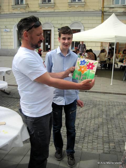 pictorul Iurie Cojocaru încurajează copii